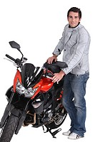 Young man standing next to a motorcycle