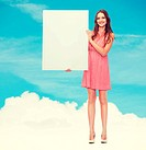 beauty, fashion, advertising and happy people concept - young woman in dress with white blank board