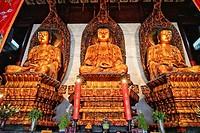 Medicine, Sakyamuni and Amithaba gold Buddha statues, Heavenly King Hall, Yufo Si, Jade Buddha Temple, Shanghai, China, Asia.
