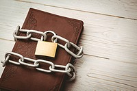 Open bible chained with lock