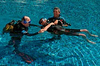 Handicapped diver with dive instructor