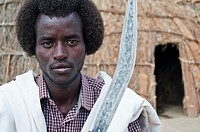 A young man belonging to the Kereyu tribe is showing his knife. Oromiya state Ethiopia.