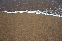 beach tropical with brown sand and clear water