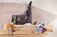Man working under wooden plank