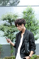 Asian young man using mobile phone
