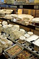 France, Paris. French cheeses at a market