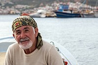 ISLAM ON HIS BOAT, FISHERMAN FROM THE VILLAGE OF YENIFOCA, THE OLIVE RIVIERA, NORTH OF IZMIR, TURKEY