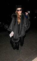 Paris Hilton returns to her hotel wearing a fur coat, following a trip to Winter Wonderland Featuring: Paris Hilton Where: London, United Kingdom When...