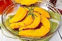 Pumpkin baked in glass pan on board