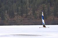 Ice boating on frozen lake