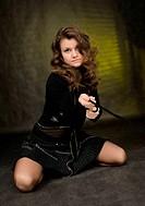 Girl in black on dark background