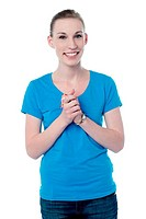 Happy young girl with clasped hands