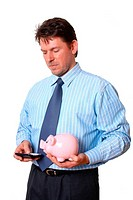 Businessman with piggy bank in hand calculate on the calculator
