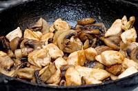 Roasted mushrooms in a pan closeup