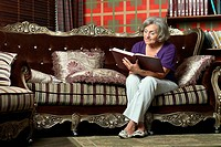 Retired woman reading book