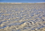 Wind warning: a body of water surrounded by sand dunes known as Lake of the Rivers in southern Saskatchewan.