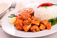 chicken cooked with curry and coconut with rice