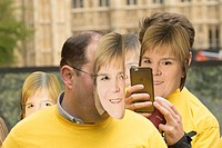 A flash mob wearing face masks of SNP politician Nicola Sturgeon pose in Victoria Tower Gardens to highlight the risk of Ed Miliband as Prime Minister...