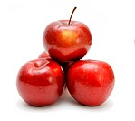 Four red apples in a pyramid isolated