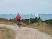 a biker at the sea