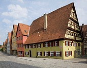 Gingerbread style commercial and residential apartment buildings in the medieval town of Dinkelsbuhl in late summer, Germany.