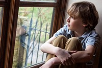 Sad Young Boy Child Looking Out Window