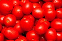 Red tomatoes by background