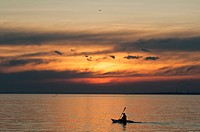 Person kayaking on Port Phillip Bay at sunset, Melbourne.
