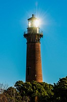 Currituck Beach Lighthouse with Morning Sunlight Reflected.