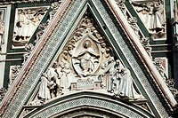 Florence - beautiful composition with Virgin Mary above the portal on the facade of the Santa Maria del Fiore cathedral
