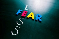 Less fear concept on blackboard