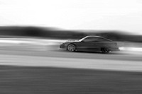 Very fast driving, motion blur drift black and white