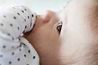 Close-up of baby with finger in mouth