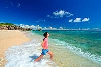 The girl enjoys herself in a beach
