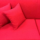Pink sofa with cushions