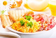 breakfast with scrambled eggs, juice and fruits