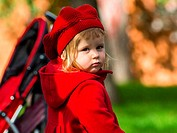Cute little girl dressing in red coat