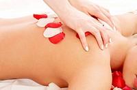 massage hands and rose petals