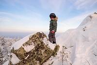 Portrait of boy standing on snow covered rock, Nizhniy Tagil, Sverdlovsk Region, Russia