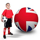 Child soccer player with United Kingdom ball