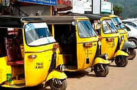 Yellow auto rickshaws lined up in Ooty, Nilgiri Hills, Tamil Nadu