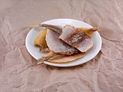 Sea bream fish on a white plate