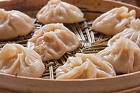 Dumplings on bamboo steamer (1)