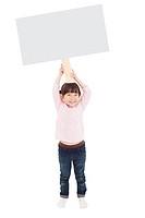 happy little girl showing the blank billboard