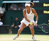 (150704) -- WIMBLEDON, July 4, 2015 () -- Heather Watson of Britain returns the ball during the lady's third round match against Serena Williams of th...