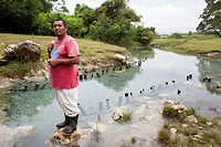 (150710) -- SAYAXCHE, July 10, 2015 () -- A man stands on a tributary of the Passion River in the municipality of Sayaxche, department of El Peten, Gu...