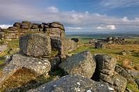Early morning sunlight illuminates the granite rocks of Rowtor in the north of Dartmoor National Park, Devon, England, United Kingdom, Europe
