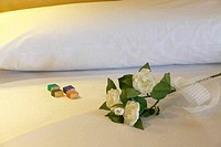 Bridal bed with roses and chocolates
