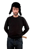 man in hat ear flaps holding axe