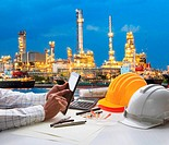 engineering working on computer tablet against beautiful oil re